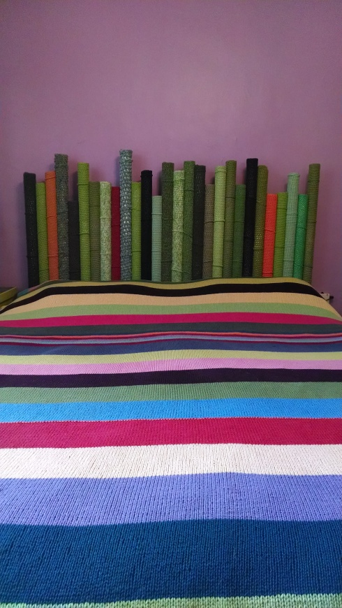 I do not intend the stripey blanket to be used as a bedspread, this is a bit too over the top for me, but you can see it with the new wall color here, too, I guess. And it's too hot for a bedspread in the summer.